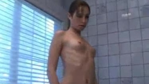 Sexy brunette doing some masturbating in the bath tub