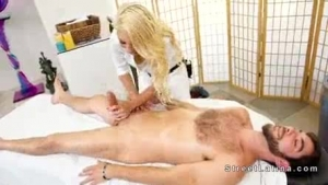Beautiful blonde masseuse in stockings sucks and fucks her client